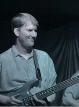 PHOTO: roman warmke with bass guitar