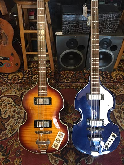 photo of two bass guitars